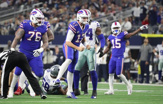 Bills quarterback Josh Allen dives in for the first down after recovering his on fumble in the second quarter at AT&T Stadium in Arlington, Texas, on Nov. 28, 2019.  (James P. McCoy/Buffalo News)