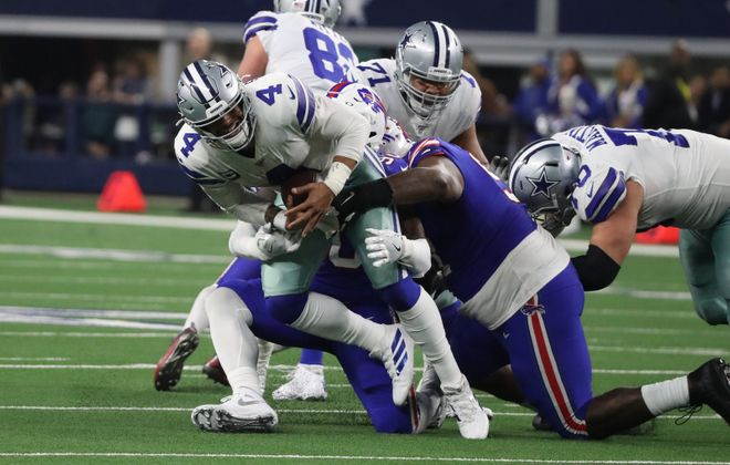 Shaq Lawson and Jordan Phillips sack Dak Prescott in the third quarter. (James P. McCoy/Buffalo News)