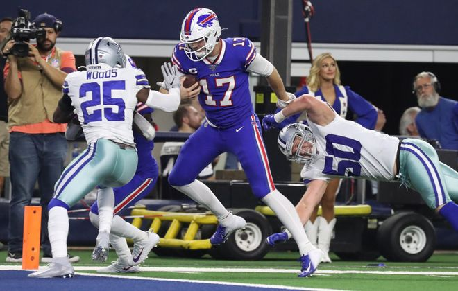 Buffalo Bills quarterback Josh Allen (17) rushes for a touchdown over Dallas Cowboys outside linebacker Sean Lee (50) in the third quarter at AT&T Stadium in Arlington, Texas, on Thanksgiving Day. (James P. McCoy/Buffalo News)