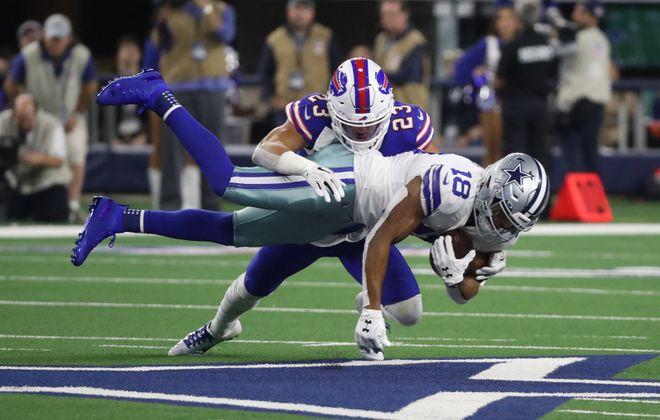 Bills strong safety Micah Hyde tackles Dallas Cowboys wide receiver Randall Cobb. (James P. McCoy/News file photo)
