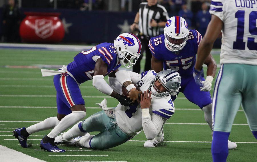 Bills cornerback Tre'Davious White tackles Cowboys QB Dak Prescott during the Nov. 28 game. (James P. McCoy/Buffalo News)