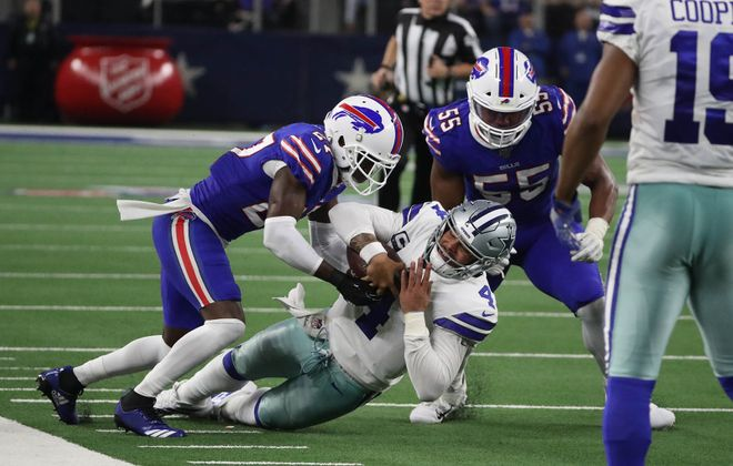 Bills cornerback Tre'Davious White tackles Cowboys QB Dak Prescott during the Nov. 28 game. (James P. McCoy/Buffalo News)
