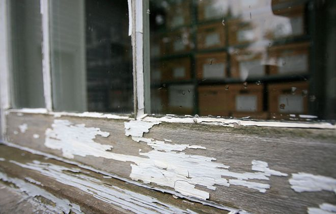 Cracking or peeling lead paint that can flake off or get disturbed every time a window or door is opened is hazardous, especially to children. (Harry Scull Jr./News file photo)
