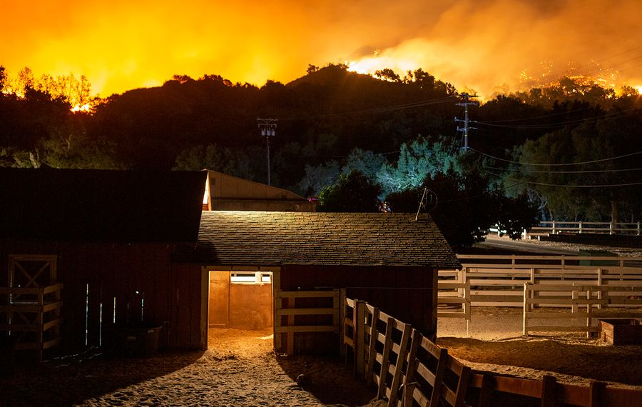 A ranch is threatened by the Maria Fire as it explodes to 8,000 acres on its first night on Nov. 1, 2019, near Somis, Calif. Southern California has been hit by a series of dangerous, fast-moving wildfires as Santa Ana winds ushered in strong gusts up to 80 mph and extremely low humidity. (David McNew/Getty Images)
