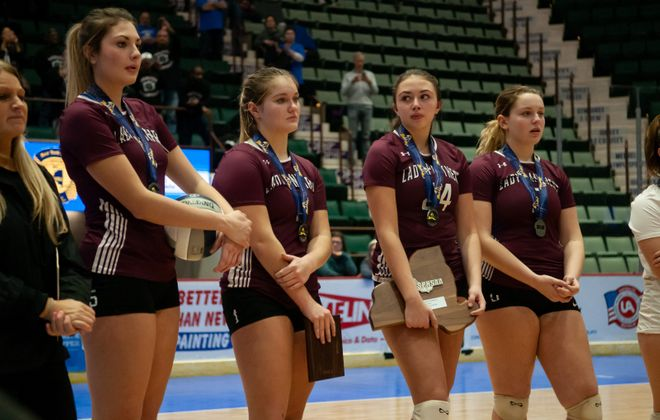 Portville volleyball players watch as Valhalla receives its first-place medals. (Jenn March/Special to The News)