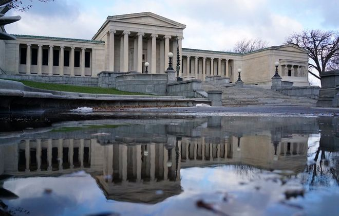 The Albright-Knox Art Gallery is reflected in a puddle on Lincoln Parkway. (Derek Gee @DerekGeePhoto)