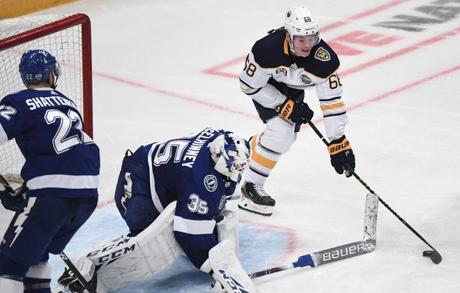 Victor Olofsson of Buffalo Sabres (R) shoots to score past goalkeeper Curtis McElhinney of Tampa Bay Lightning during the NHL Global Series Ice Hockey match Tampa Bay Lightning v Buffalo Sabres in Stockholm on November 9, 2019.  (Photo by JONATHAN NACKSTRAND/AFP via Getty Images)