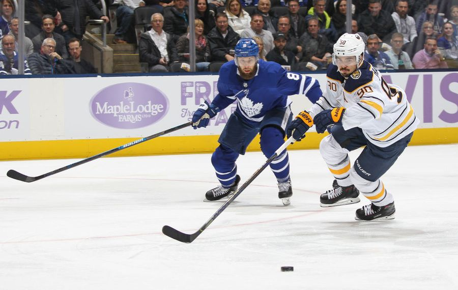 Buffalo Sabres forward Marcus Johansson skates after a puck against Toronto Maple Leafs defenseman Jake Muzzin Saturday night in Scotiabank Arena. (Getty Images)