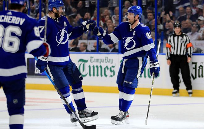 Steven Stamkos, right, and Victor Hedman celebrate following a goal against the New York Rangers on Nov. 14. (Getty Images)