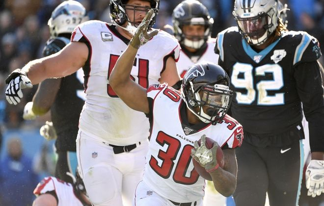 Qadree Ollison of the Atlanta Falcons reacts after scoring his first NFL touchdown against the Carolina Panthers. (Getty Images)
