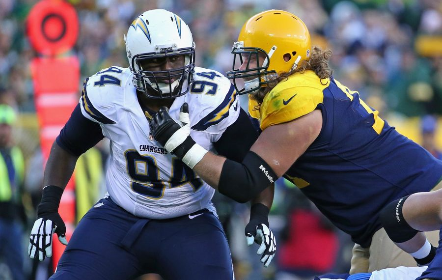 Corey Liuget, in action with the Los Angeles Chargers, rushes against Josh Sitton of the Green Bay Packers. (Getty Images)