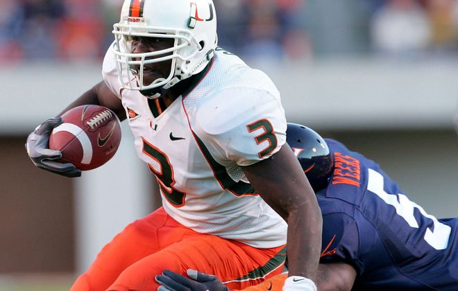 Frank Gore of the Miami Hurricanes carries the ball against Virginia in 2004 (Jamie Squire/Getty Images)