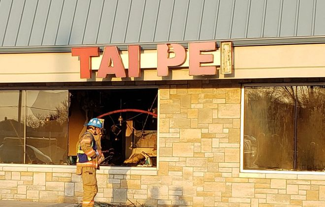 Crews from the Grand Island Fire Company extinguish a blaze Tuesday at the Tai Pei restaurant on Grand Island Boulevard that caused an estimated $200,000 in damages. (Harold McNeil/Buffalo News)