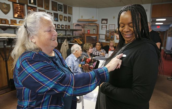 "Elections inspector Edna Folvarcik gives an ""I Voted"" sticker to Jazette Allen, right, after Allen voted early in Cheektowaga on Oct. 26, 2019. In all, 4.2% of Erie County's eligible voters voted during the nine days of early voting introduced for the first time in 2019 by New York State. (Robert Kirkham/Buffalo News)"