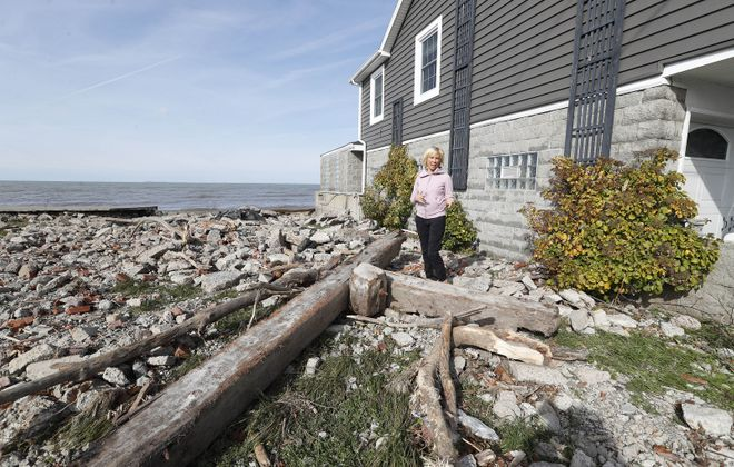 Leanne Powers shows the damage at her Hoover Road home at Hoover Beach in Hamburg. (Sharon Cantillon/Buffalo News)