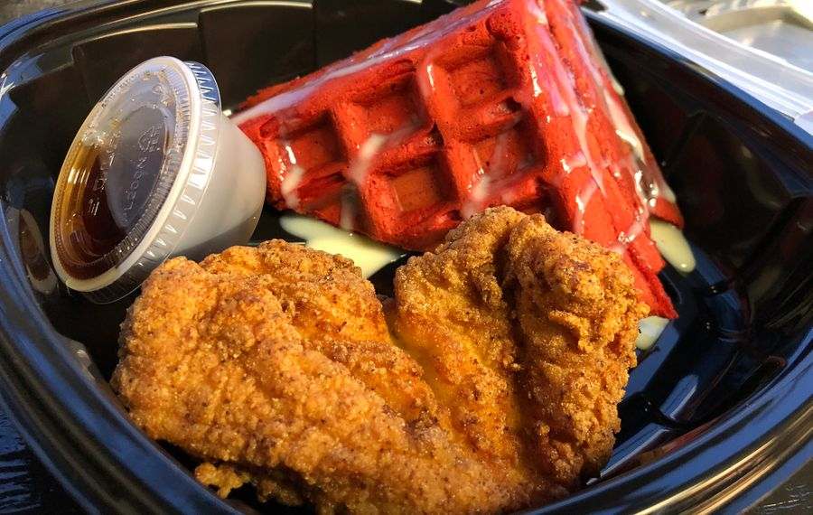 The restaurant's namesake – chicken and waffles – is available with a few different waffle flavors. Pictured is red velvet. (Ben Tsujimoto/Buffalo News)