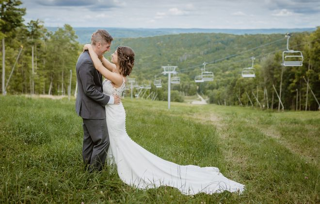Molly knew right away that this dress was the one. The lace-top gown with illusion straps and sheer bodice buttoned all the way down the back featured simple details she loved. (Becca Sutherland)