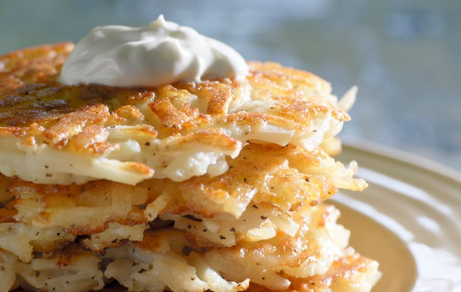 Family tradition reigns when making latkes
