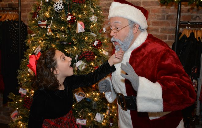 """""""Oh my goodness, it is real!"""" Susan Walker (Isabella Bindeman) tests Kris Kringle (Elliot Fox) in Miracle on 34th Street: A Live Musical Radio Play.  -photo by Gary McBride"""