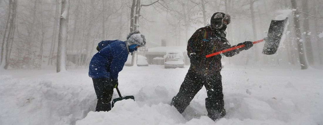 Tre Henry, left, and his brother Chris, shovel the heavy snow at their home in Orchard Park on Nov. 18, 2014. After the second blast of lake-effect snow, Orchard Park's tally was 71 inches of snow. Mark (Mulville/Buffalo News)