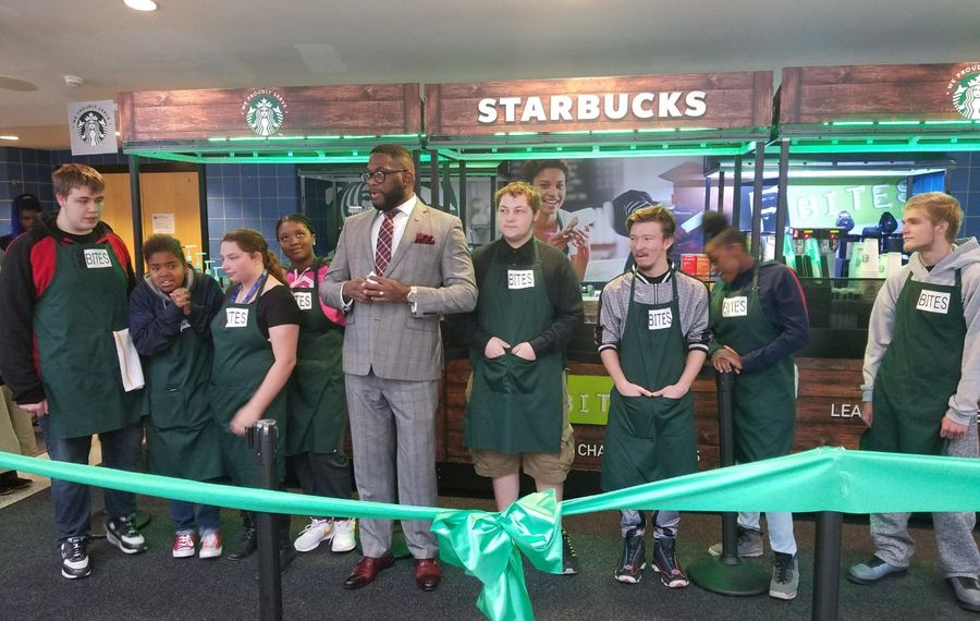 Chef Bobby Anderson, in suit, with the student crew at the opening of a Starbucks in Niagara Falls High School on Nov. 1, 2019. (Thomas J. Prohaska/Buffalo News)