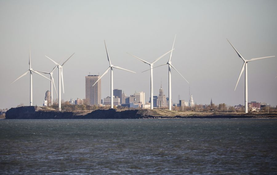 Wind turbines from the Steel Winds wind energy plant on the former Bethlehem Steel site in front of the Buffalo skyline across Lake Erie from Hamburg Town Park. (Derek Gee/Buffalo News)