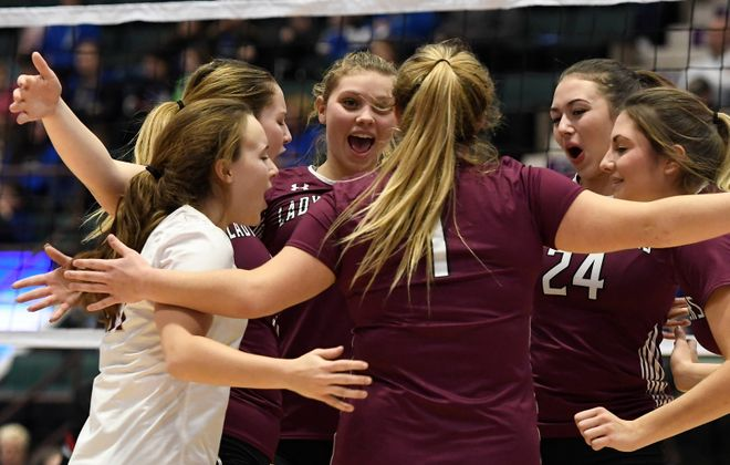 Portville volleyball players celebrate a point against Pierson-Bridgehampton during semifinal pool play. (Jenn March, Special to the Buffalo News)