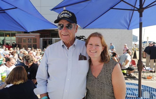 Kelly Sullivan, granddaughter of Albert Sullivan, stands with Bill Mackie, cousin of Jerry Reilly, at Buffalo's Naval and Military Park in 2017 during the 27th-anniversary reunion of those who served on the USS The Sullivans.  (Mark Mulville/News file photo)
