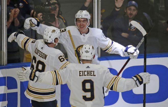Jimmy Vesey celebrates his third goal in three games with Victor Olofsson and Jack Eichel. (Robert Kirkham/Buffalo News)