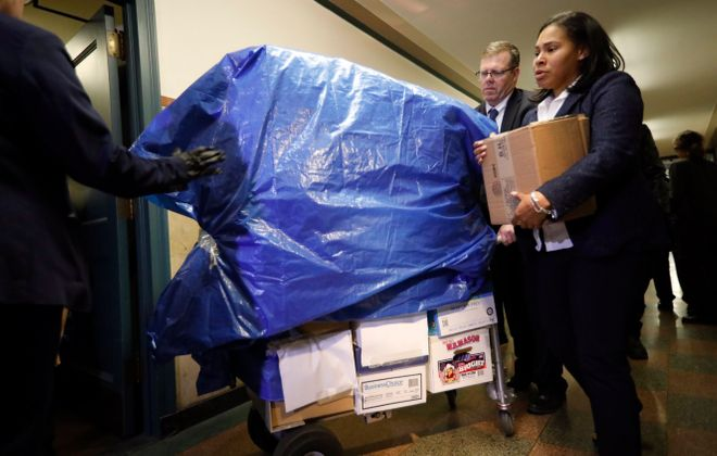 Federal agents investigating public corruption in Buffalo seized three carts full of documents from a Buffalo City Hall office on Nov. 6. (Derek Gee/Buffalo News)
