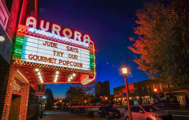 The Aurora Theatre's marquee illuminates Main Street. (Dave Jarosz)