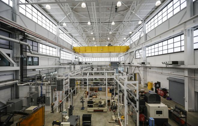 The high-bay area features high-tech machines at the new Buffalo Manufacturing Works space in the Northland complex. (Derek Gee/Buffalo News)