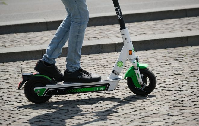A man rides a Lime electric scooter in Berlin. (Sean Gallup/Getty Images file photo)