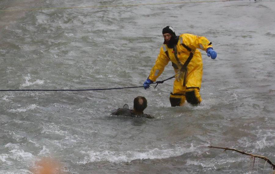 A rescuer approaches a man in the rapids above the American Falls in Niagara Falls on Thursday, Nov. 7, 2019. (Derek Gee/Buffalo News)