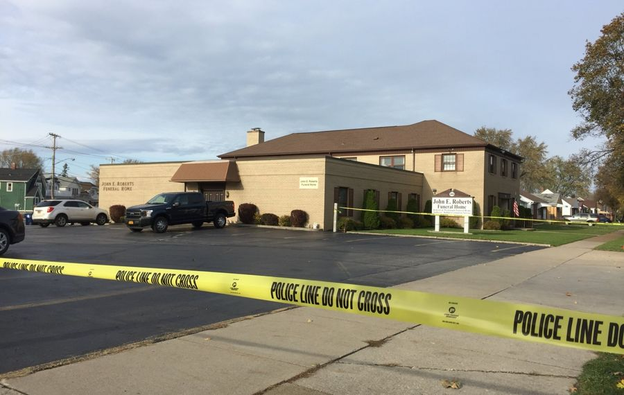 Yellow crime scene tape could be seen on Nov. 4 outside the John E. Roberts Funeral Home on Grover Cleveland Highway. Charles Durante, a funeral home director there, was found in the middle of the road and later died in what police now say was a suicide. (Aaron Besecker/Buffalo News)