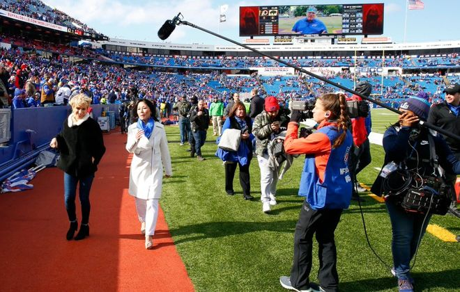 """Bills co-owner Kim Pegula, right, is interviewed by """"Shark Tank's"""" Barbara Corcoran for a segment on """"NFL: The Grind."""" (Harry Scull Jr./Buffalo News)"""