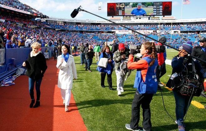 Kim Pegula and Barbara Corcoran walk together at New Era Field during a segment for an Epix show (Harry Scull Jr. / Buffalo News)