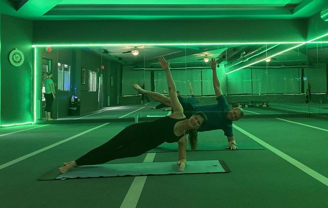 Gina and Bill Barrett believe they are the first in the region to offer Inferno Hot Pilates classes, which they started recently at Kula Yoga in the Village of Hamburg. (Photo courtesy of Kula Yoga)