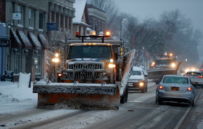 A plow driver clears snow on Main Street in Hamburg on Tuesday morning. (Mark Mulville/Buffalo News)