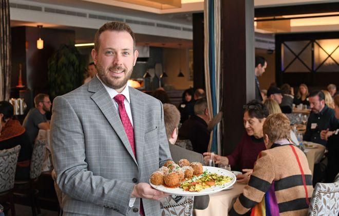 NFCI Hospitality Instructor Daniel DiPirro presents a plate of arancini featured on the seasonal menu at Savor. (Photo courtesy of Niagara Falls Culinary Institute)