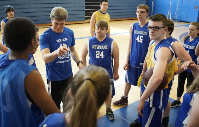 Coach Justin Balcom talks to the Newfane High School Unified Basketball Team at the end of practice in the school gym. (Derek Gee/Buffalo News)