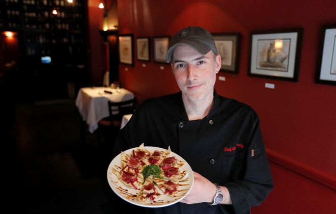 Chef Chris Murphy holds the tuna crisps at Forte. (Mark Mulville/Buffalo News)