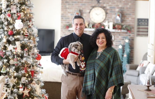 Joe and Angela Vacanti, along with Clementine the Shorkie (Shih Tzu/Yorkie mix), are ready for Christmas.         (Mark Mulville/Buffalo News)