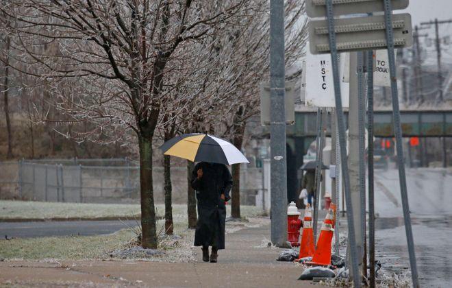 A woman walks along Military Road in Buffalo. (Robert Kirkham/Buffalo News)