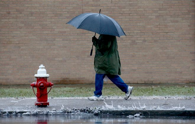 Tuesday morning commuters might need their umbrellas again. (Robert Kirkham/Buffalo News)