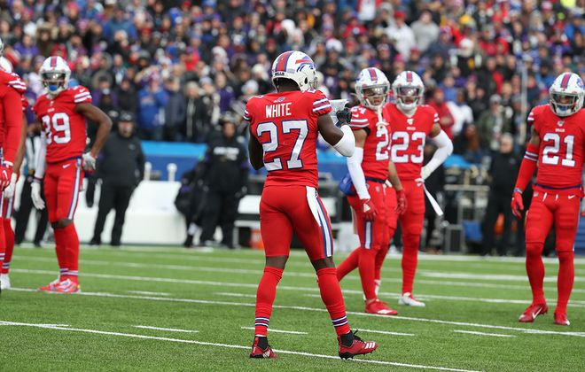 Buffalo Bills cornerback Tre'Davious White (27) picks up a play that blew onto the field from the Baltimore Ravens bench in the fourth quarter at New Era Field in Orchard Park,N.Y. on Sunday, Dec. 8, 2019. (James P. McCoy/Buffalo News)