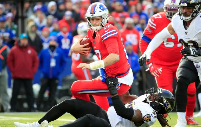 Buffalo Bills quarterback Josh Allen takes a sack against Baltimore last season. (Harry Scull Jr./News file photo)