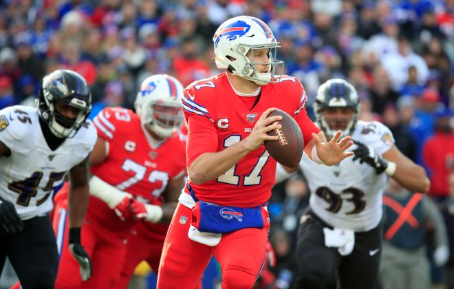 Buffalo Bills quarterback Josh Allen looks for a receiver against the Baltimore Ravens during the first quarter at New Era Field.  (Harry Scull Jr./Buffalo News)