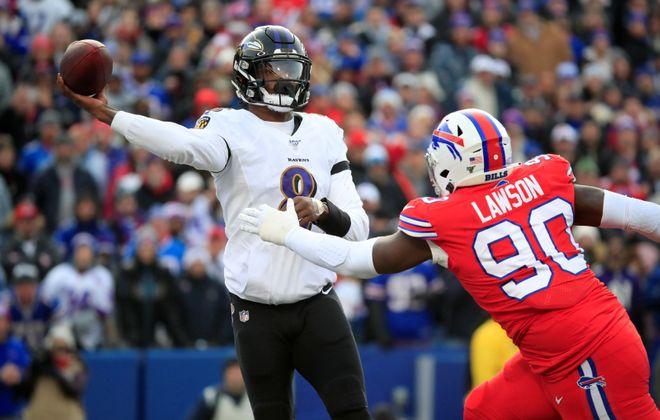 Bills defender Shaq Lawson pressures Ravens quarterback Lamar Jackson during the second quarter last week. (Harry Scull Jr./Buffalo News)