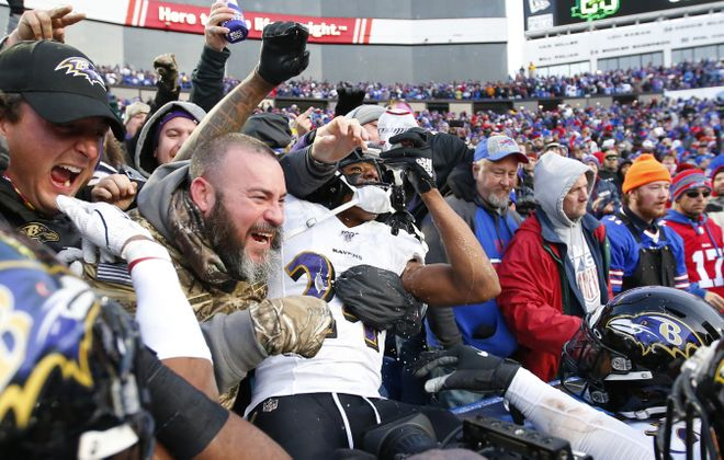 Baltimore Ravens defender Marcus Peters chugs a beer in the stands after breaking up a Buffalo Bills pass during the fourth quarter at New Era Field,  (Harry Scull Jr./Buffalo News)